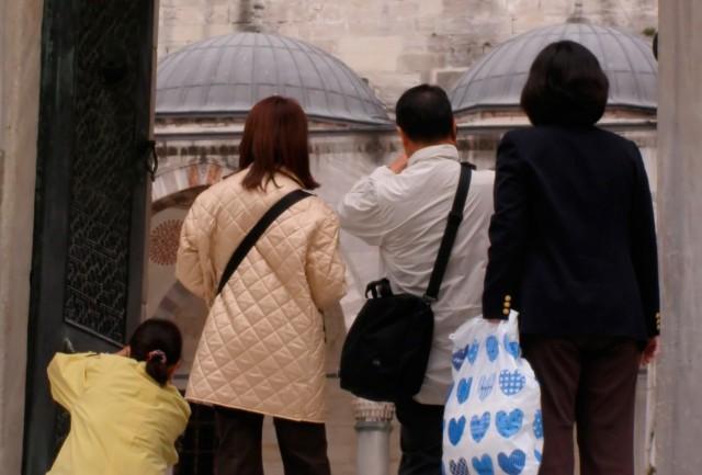 Turister på billederne